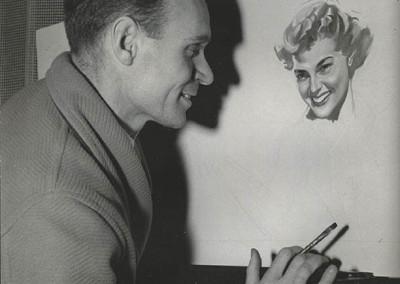 Rino Ferrari nel suo studio a Parigi davanti a uno dei suoi ritratti nel 1950